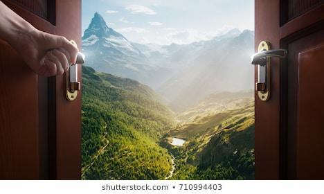 hand-opens-empty-room-door
